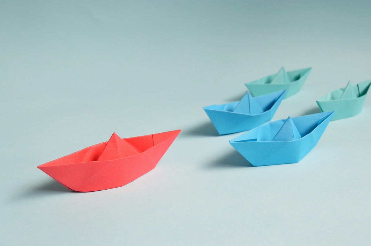Paper ships to show one leading